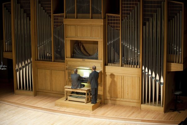 Joel Bacon pictured playing the Organ Recital Hall Casavant organ