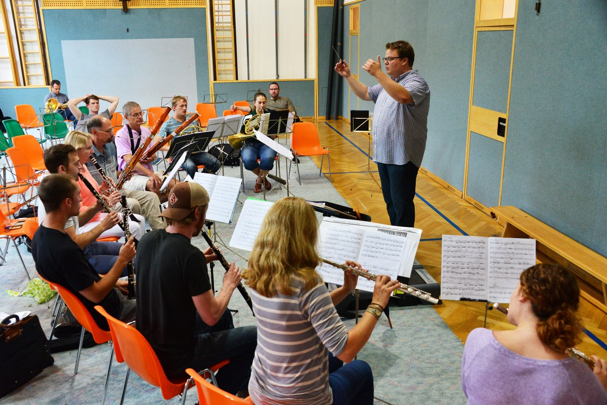 conductor directing students