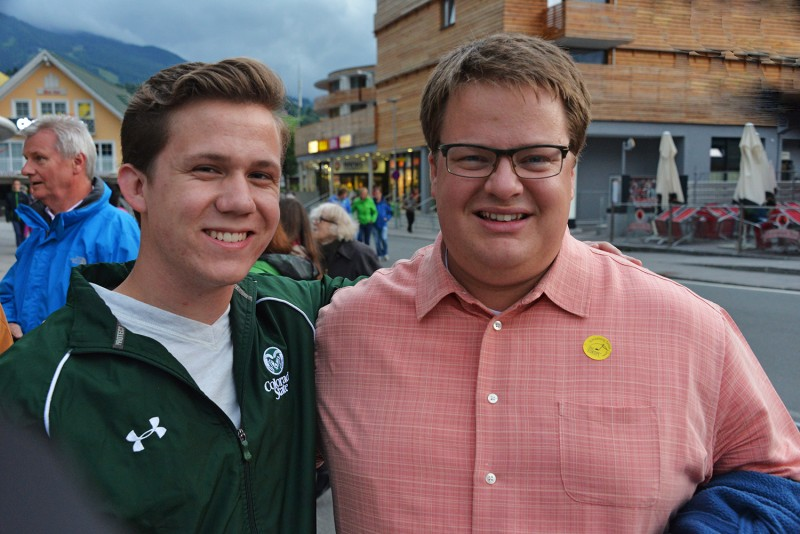 Spencer Poston and Richard Frey wait for the marching band exhibition to begin.