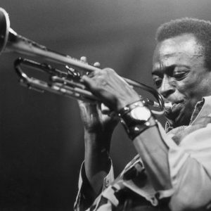 American jazz musician and composer Miles Davis (1926 - 1991) playing the trumpet.