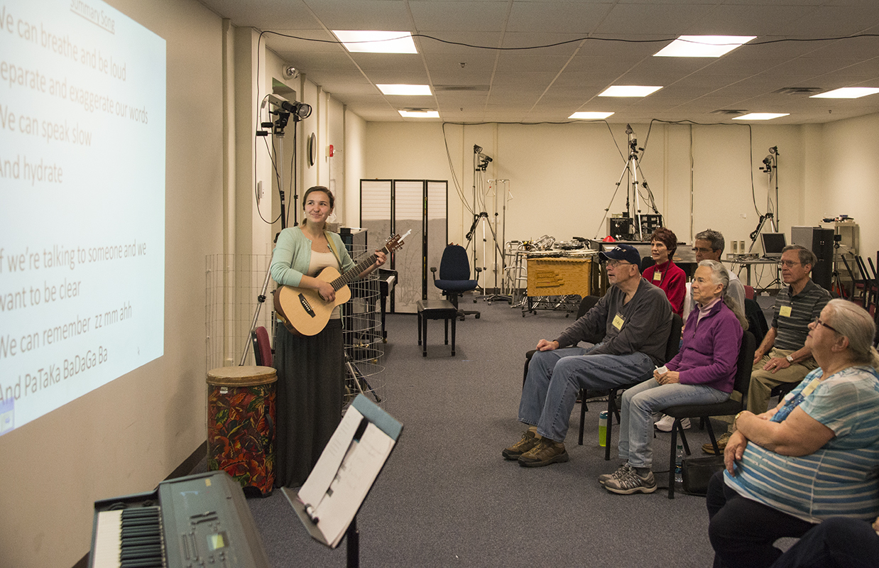 Student pictured leading a music therapy class