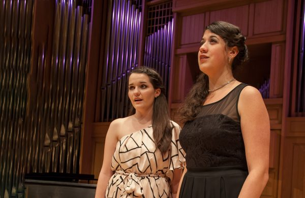 Two voice students pictured singing