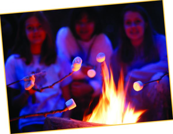 Students pictured roasting marshmallows