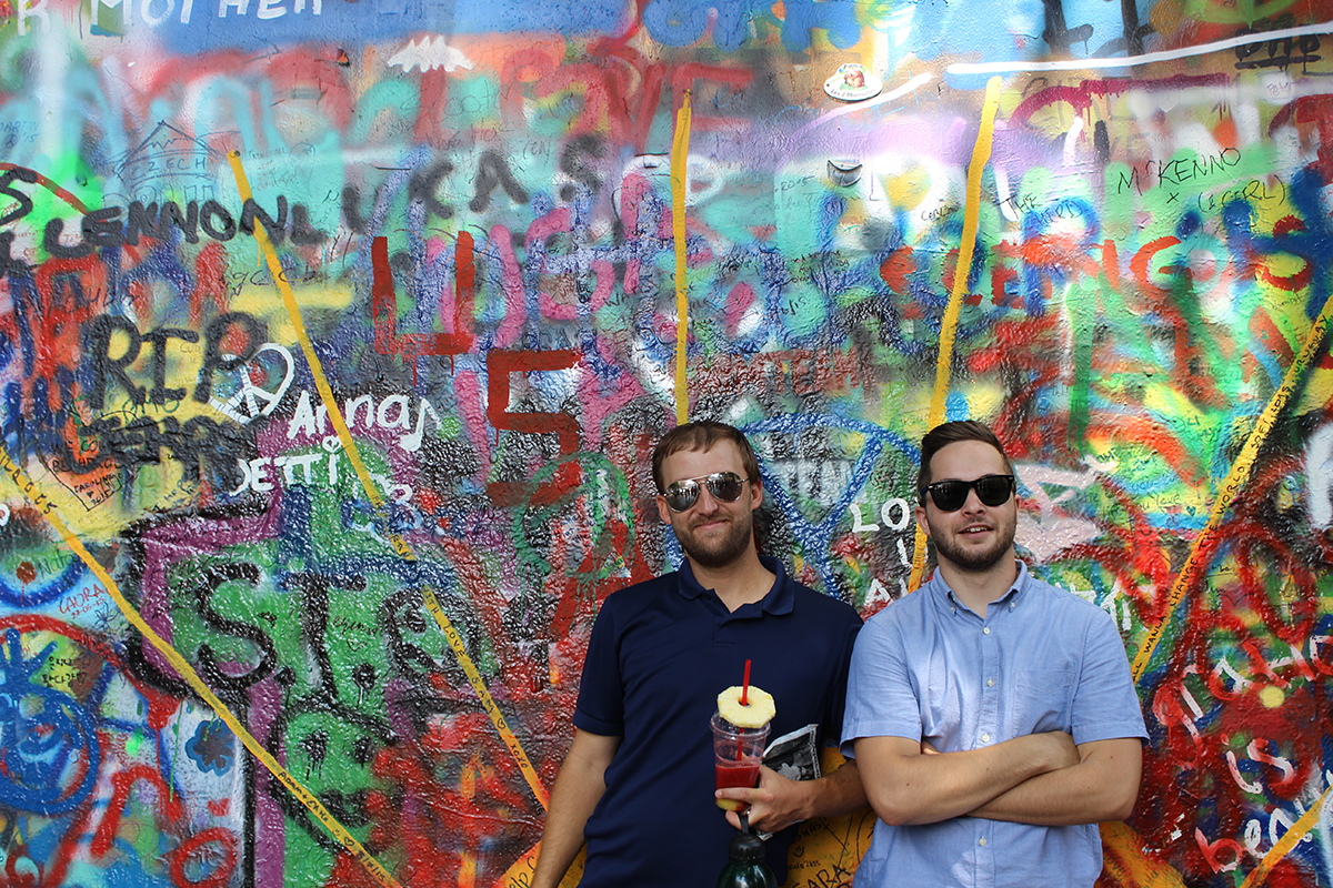 Bryan Kettlewell and Dean Rieger pictured in front of the John Lennon Wall in Prague, Czech Republic.
