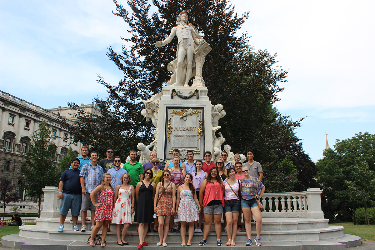 The 2015 Chamber Choir group pictured in front of the Mozart Statue in Burggarten, Vienna, Austria.