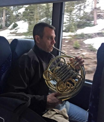 John McGuire practices on the bus ride to Grand Junction.