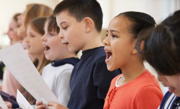 children pictured singing