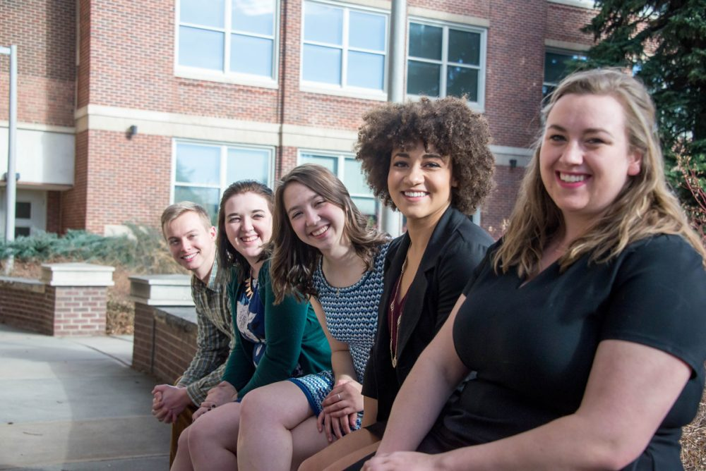 CSU voice students who won awards are pictured in front of the University Center for the Arts