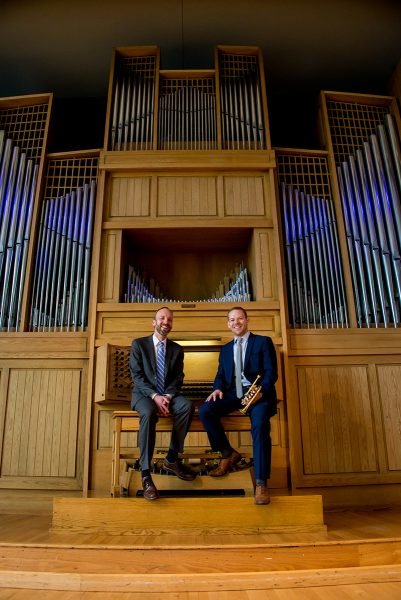 Joel Bacon and Caleb Hudson in front of the Casavant Organ at CSU