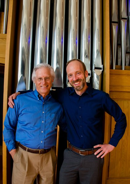 Wes Kenney and Joel Bacon in front of the Casavant Organ at CSU
