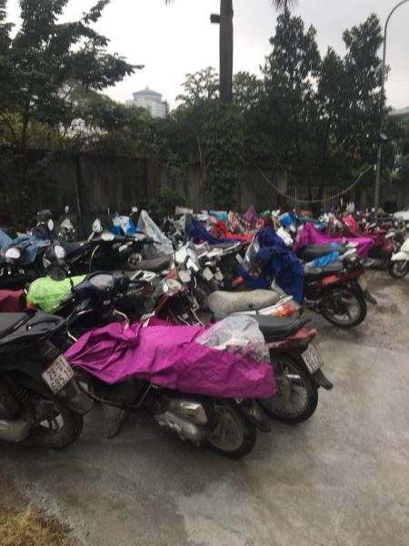 parking lot full of motorcycles covered in traps
