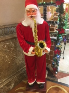 Figurine of santa with a saxophone