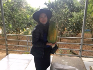 Lan posing with giant fruit