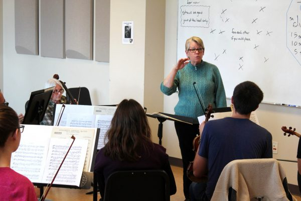 Dr. Leslie Stewart rehearses with the CSU Concert Orchestra