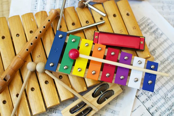 brightly colored children's instruments pictured