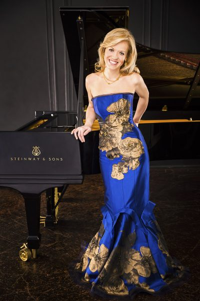 Full length photo of Olga Kern standing by a piano
