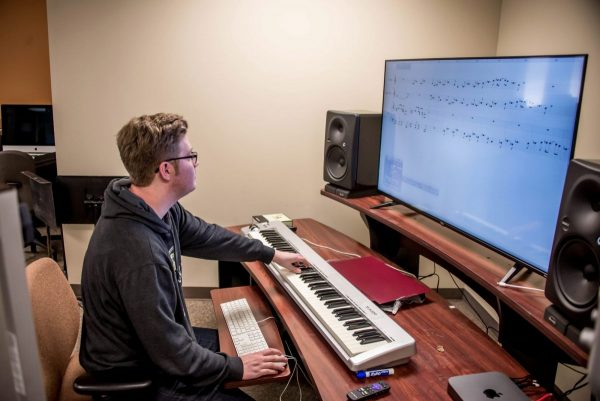 Music composition major, Derek Summers, works in Finale