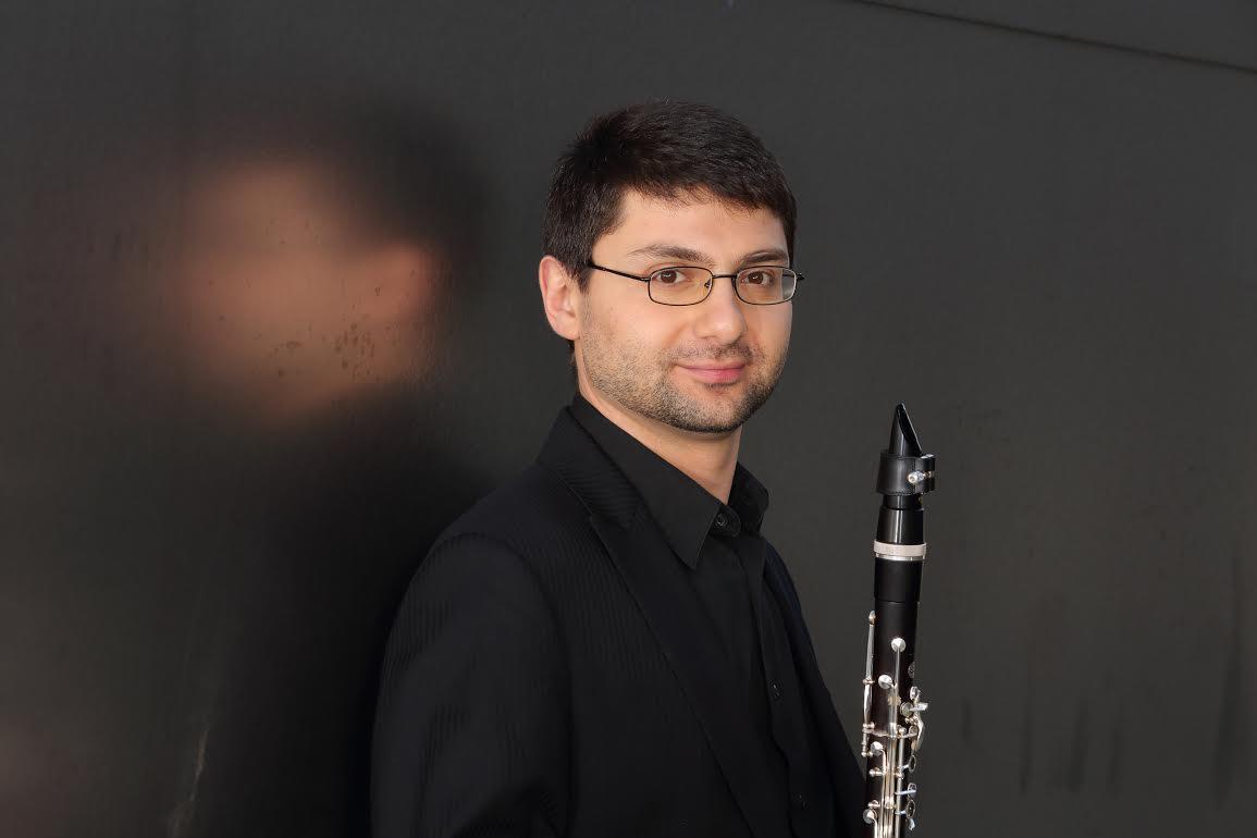 Boris Allakhvergyan headshot - pictured with a clarinet