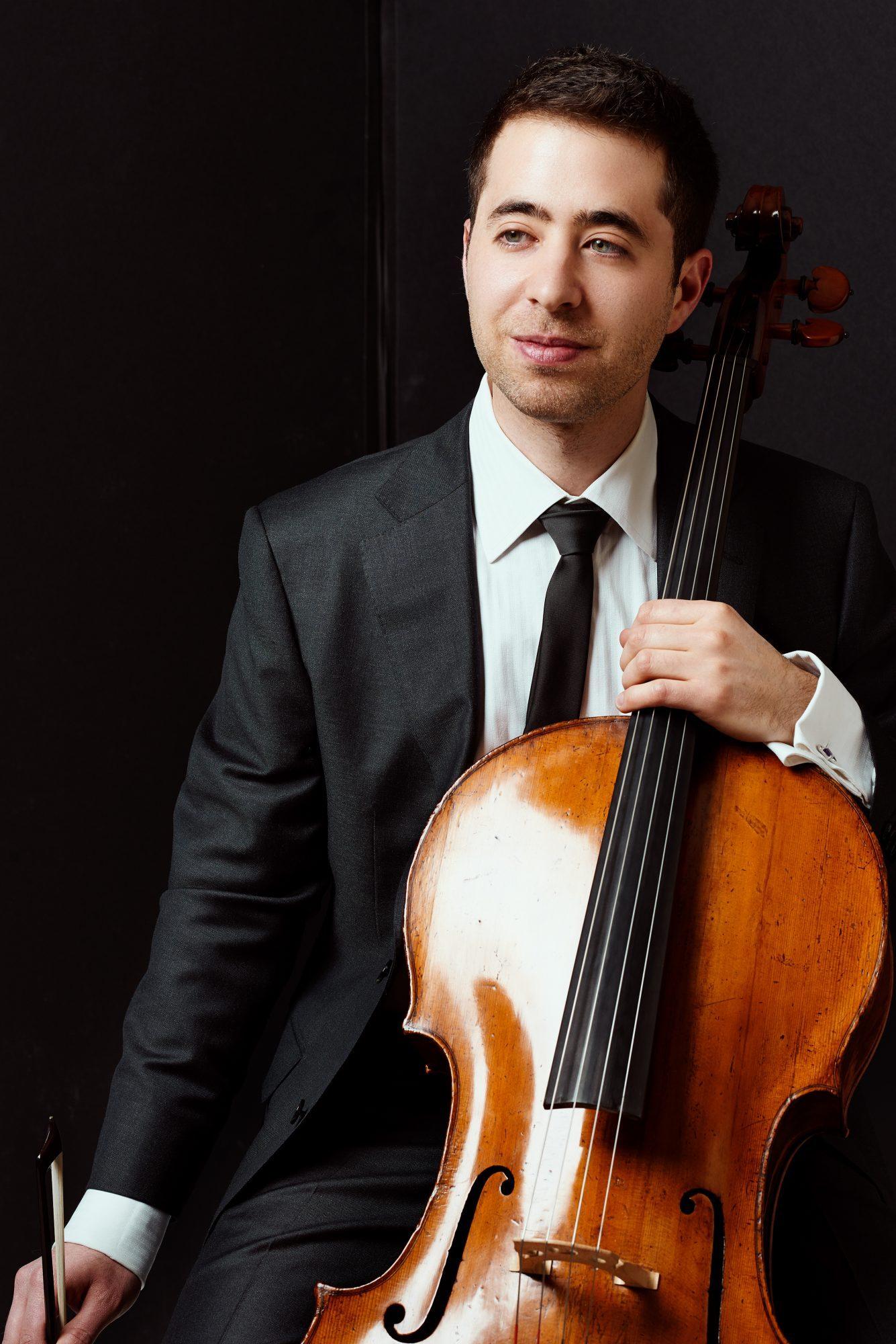 Matthew Zalkind headshot - pictured with a cello