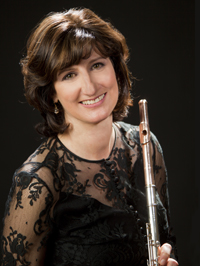 Mindy Kauffman headshot - pictured with a flute