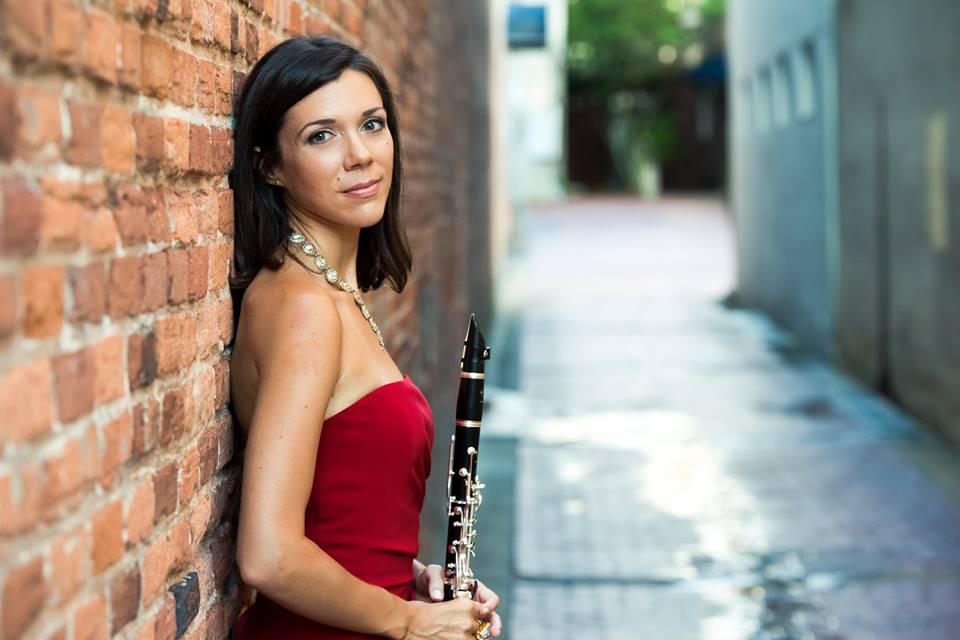 Jackie Glazier headshot - pictured with a clarinet