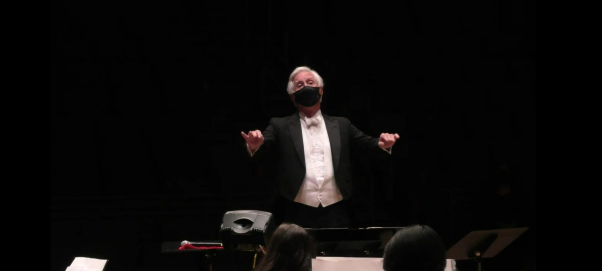 Wes Kenney pictured conducting Fall 2020 USO performance